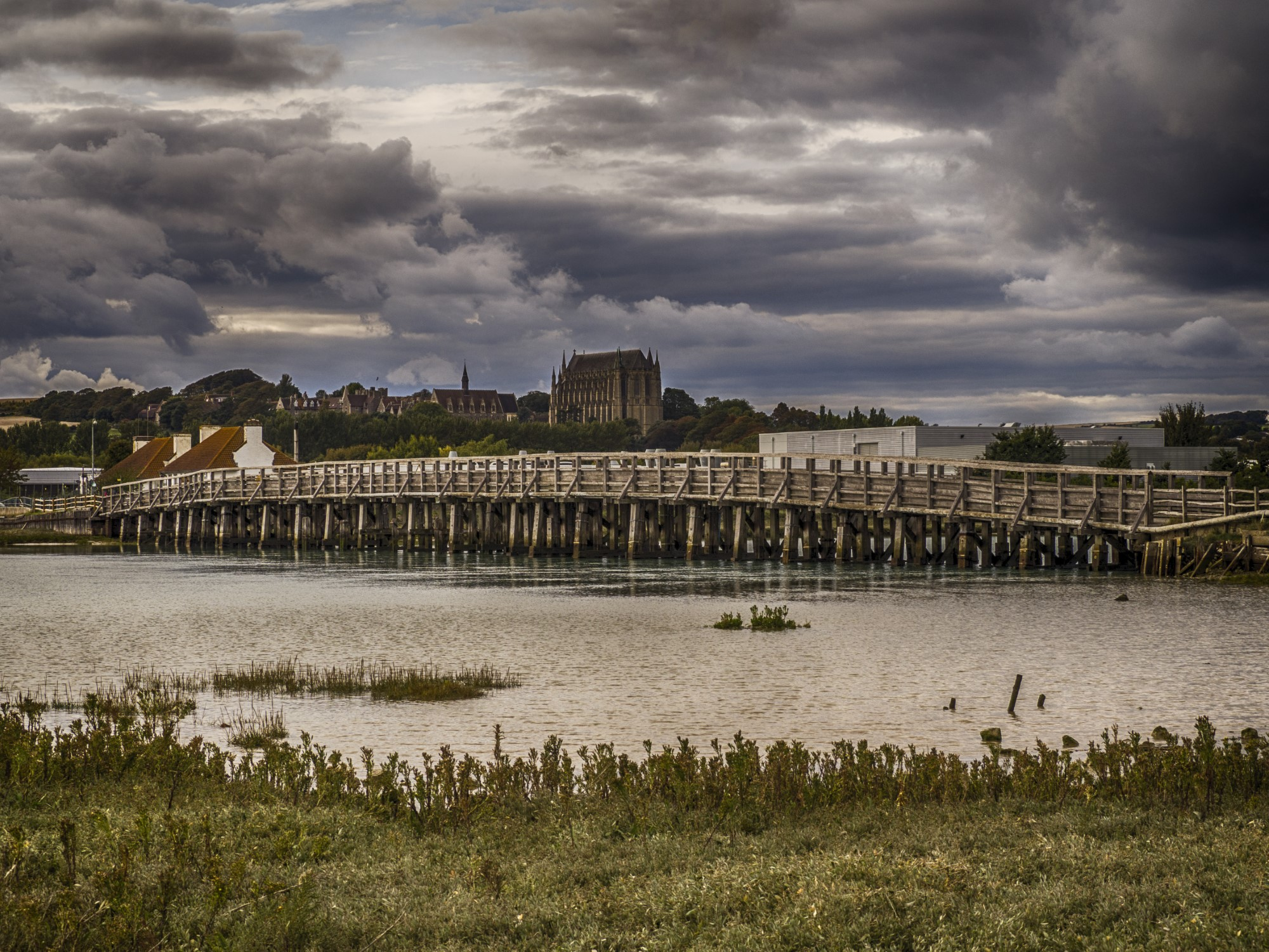 The Old Toll Bridge over the River Adur, Shoreham-by-Sea. Lancing College in the background.